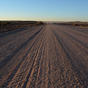 Straight flat sandy road in Namibia