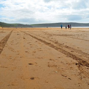 Family walk on the beach in West coast, England