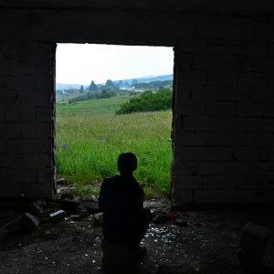 Waiting for the rain go at the abandoned house in Bosnia