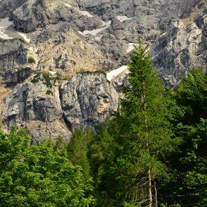 A lady sleeping inside the rocks in Julian Alps