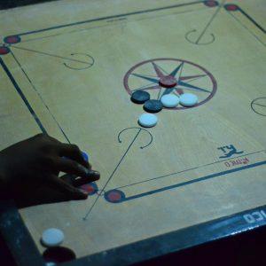 Playing the board game in Zanzibar