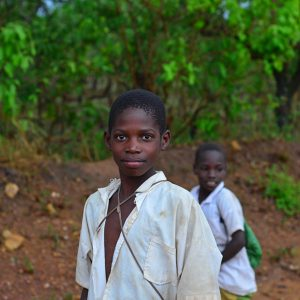 A boy from school back to home in Tanzania