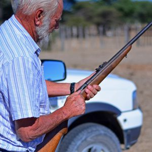 A Namibian farmer just about to shoot his cow.