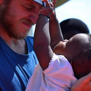 Play with Elliot on the boat in Rwanda